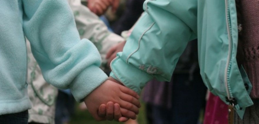 Holding Hands at Puddletown Montessori Preschool in Portland Oregon