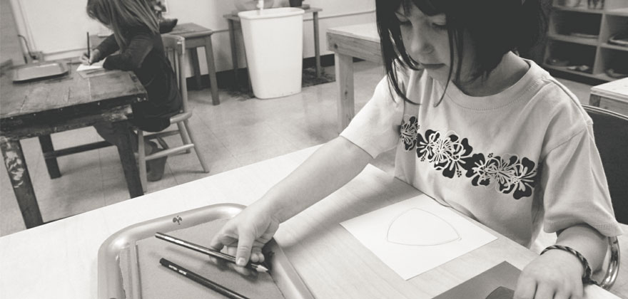Child studying at Puddletown Montessori Preschool in Portland, Oregon